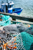 Drying fishing nets in port — Stock Photo