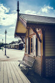 Retro touristic train station — Stock Photo