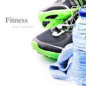 Sport shoes and water bottle — Stock Photo