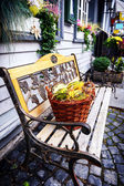 Street bench with autumn decoration — Stock Photo