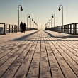 Sunrise over the pier at the seaside - Stock Photo