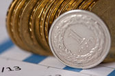 Piles of golden coins on white background, polish zloty coins — Stockfoto