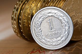 Piles of golden coins on white background, polish zloty coins — Stock Photo