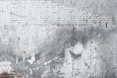 Cracked concrete old brick wall background — Stock Photo