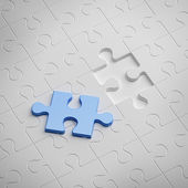 Blue piece of white puzzle — Stock Photo
