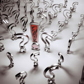 Silver questions and red answer — Stock Photo