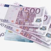 Credit card and Euro banknotes — Stock Photo
