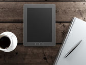 Empty tablet and a cup of coffee on the desk — Stock Photo