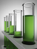 Green chemical test tubes — Stock Photo