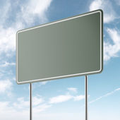Green freeway sign and sky — Stock Photo