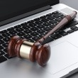 Wooden gavel on laptop — Stock Photo