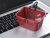 Food basket and laptop — Stock Photo
