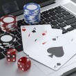 Laptop with gambling chips and poker cards — Stock Photo