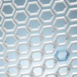 White honey combs whith blue hexagon — Stock Photo #41387855