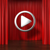 Red curtains with play button — Stock Photo
