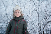 Little toddler boy with snow outdoors on beautiful — Foto Stock