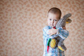 Little boy is holding his teddy  rabbit — Foto Stock