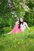 Spring Beauty Girl. Beautiful Young Woman sitting on Green — Stock Photo