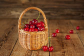 A basket filled with fresh red cherries — Stock Photo