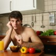 Young Muscular Man Eating His Breakfast — Stock Photo #13060993