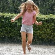 Girl in the Heavy Rain - Stock Photo