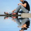 Sitting Young Man with Reflection — Stock Photo #13494195