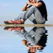 Sitting Young Man with Reflection — Stock Photo