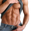 Royalty-Free Stock Photo: Young Muscular Man Showing His Abs