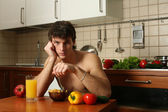 Young Muscular Man Eating His Breakfast — Stock Photo