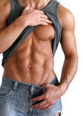 Young Muscular Man Showing His Abs — Stock Photo