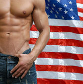 Muscular Male Torso with US Flag behind — Stock Photo