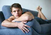Sexy Young Man on the Sofa — Stock Photo