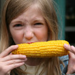 Young Girl Eating Corn — Stock Photo #13629681