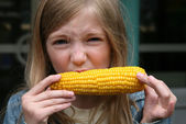 Young Girl Eating Corn — Stock Photo