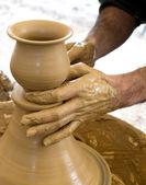 Ceramic potter hands — Stock Photo
