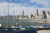 Moored boats with Benidorm as background — 图库照片