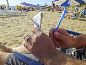 Man playing wordplay at beach — Stock Photo