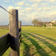 Stock Photo: A fence and a House in the Countryside