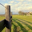 Stock Photo: Fence and House in Countryside