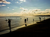 Sunset with People at the Beach — ストック写真