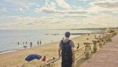 Young Man Walking in the Boardwalk — ストック写真
