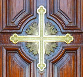 Christian Cross Symbol in a Church Door — Stock Photo