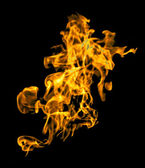 Isolated flame texture in black background. — Stock Photo