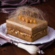 Coffee caramel cake with hazelnuts - Stock Photo