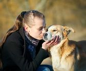 Young woman with dog outdoor day portrait — Stok fotoğraf