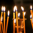 Stock Video: Candles in church .