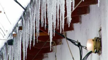 Icicles on a roof — Stock Video
