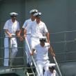 Sailors down the gangplank - Stock Photo