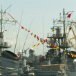 Stock Video: Warship decorated with flags