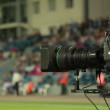 Video camera at the football game - Stock Photo